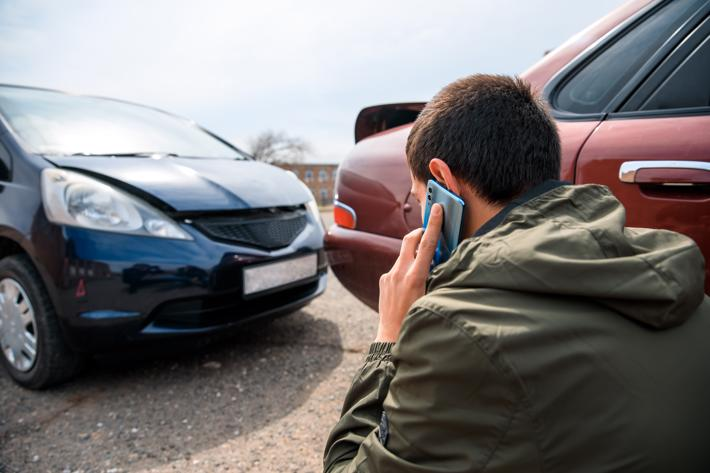 A man calling an attorney after an Uber accident in Macon.