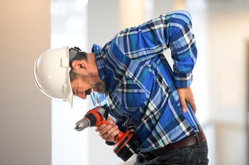 A man on a job site with a lower back injury.