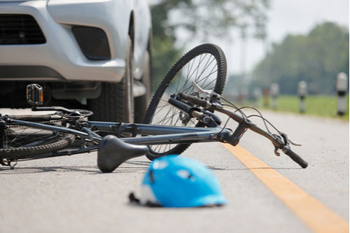 car crash with bicycle on road, call an Atlanta bicycle accident lawyer