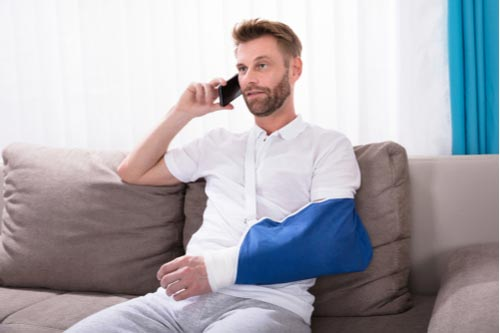 Man with broken arm calling Johns Creek personal injury lawyer