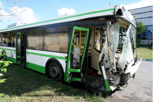 Damaged bus after crash, Atlanta bus accident lawyer concept