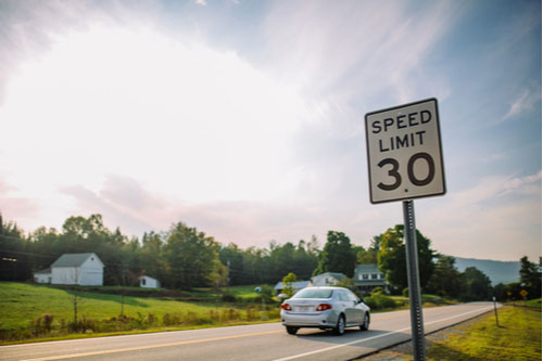 Speed limit 30 miles sign on road