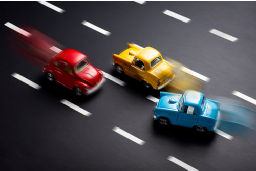 Toy model cars on road with stripes show failure to maintain a lane