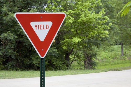 Yield sign, call an Atlanta failure to yield accident lawyer