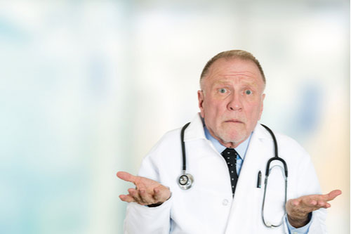 Clueless senior doctor shrugging, malpractice concept