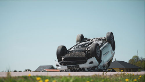 Vehicle lying on its roof after collision, rollover crash