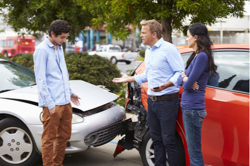 Drivers arguing after collision, contact an Atlanta teen driver accident lawyer