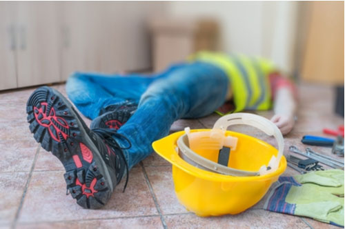 Injured worker lying on ground, Atlanta workers' compensation lawyer concept