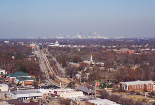 Aerial view of College Park, Georgia, with the skyline of Atlanta in the background