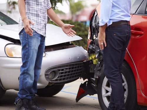 Two motorists exchanging information after a car accident in Buckhead.