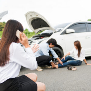 Woman at crash scene calling Fort Valley car accident lawyer for accident