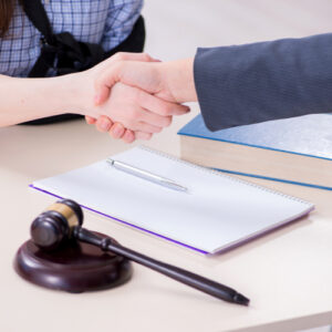 Injured client shaking hand with Fort Valley car accident lawyer in the office.