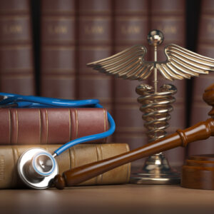 Stethoscope and law books on the desk of an Americus personal injury lawyer
