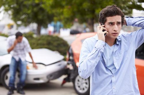 A man calling an attorney after an auto accident.