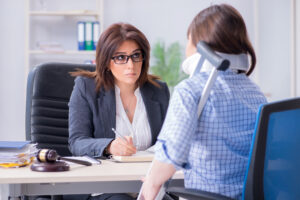 Americus personal injury lawyer consulting with injured client
