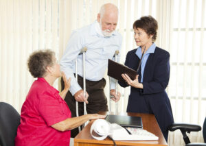 Injured man and wife speaking with Americus personal injury lawyer